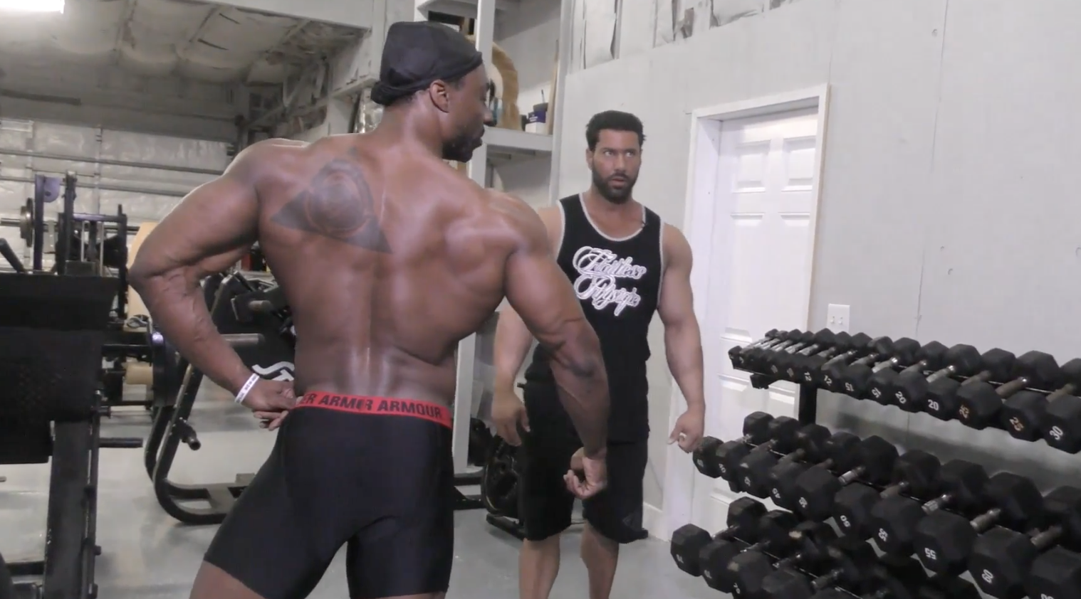 Steve Mousharbash, IFBB Pro demonstrates a posing assessment with IFBB Pro Travales Blount