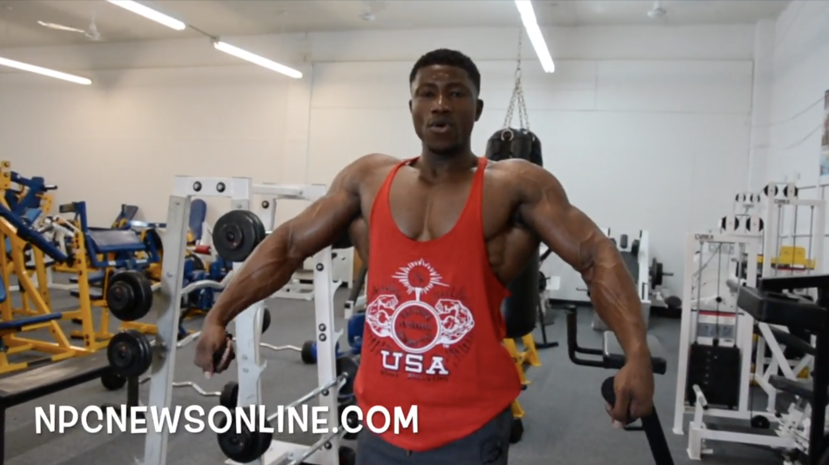 NPC Physique Athlete Mohamed Williams Posing Practice At The NPC Photo Gym
